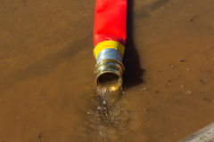 RED FIRE HOSE Stock Images
