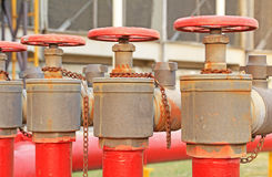 Red fire hose valve Stock Photography
