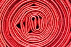 Red fire hose winder Royalty Free Stock Photo