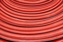 Red fire hose winder Royalty Free Stock Photography