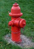 Red Fire Hydrant. On Green stock image