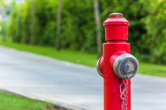 Red fire hydrant along the road close up stock photos