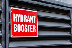 Red fire hydrant booster sign stock image