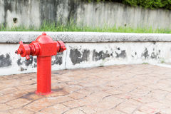 Red fire hydrant at  busy walk pavement ready for emergency Stock Photo