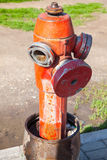 Red fire hydrant, close up vertical photo Stock Photos