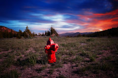Red Fire Hydrant with Colorful Sunset Stock Photo