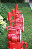 Red fire hydrant, fire main pipe,  pipe for fire fighting and fire extinguishing Stock Photography