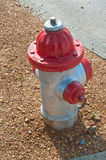 Red fire hydrant on gravel Stock Images
