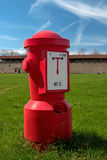 Red fire hydrant on the green grass. Royalty Free Stock Photo
