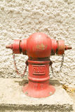 Red fire hydrant on location Royalty Free Stock Images