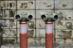 Red fire hydrant near a cement wall Royalty Free Stock Image