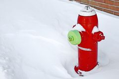 Red fire hydrant in the snow Royalty Free Stock Images