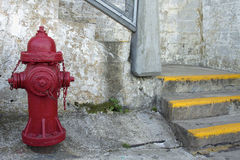 Red Fire Hydrant by the Staircase Stock Photos