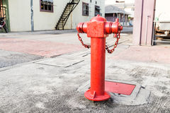 Red fire hydrant at strategic residential ready for emergency Royalty Free Stock Photography