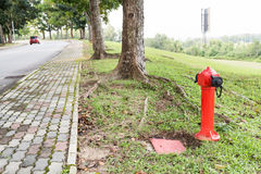 Red fire hydrant at strategic residential ready for emergency Royalty Free Stock Image