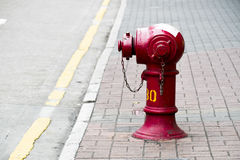 Red Fire Hydrant on the street Stock Photography
