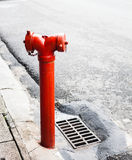 Red fire hydrant on the street Royalty Free Stock Images