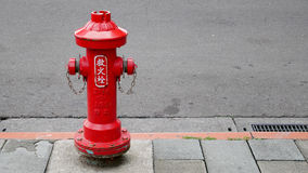 The red fire hydrant on street Stock Image