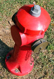 Red fire hydrant to extinguish fires in the village Stock Photos