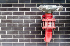 Red fire hydrant in the wall Stock Photography