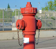 Red fire hydrant water pipe near the road.   for emergency  access Stock Image