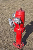 Red fire hydrant water pipe on street Royalty Free Stock Image