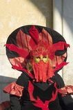 Red fire mask. Of Venice carnival 2010 Stock Photo