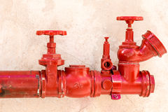 Red fire nozzle Royalty Free Stock Photos