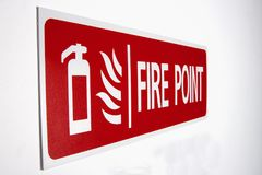 Red fire point sign. Marking a fire point station mounted on a white wall stock images
