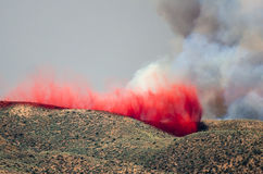 Red Fire Retardant Settling into Depression After Being Dropped on a Raging Wildfire Stock Photography