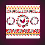 Red fire rooster embroidery as symbol of 2017. Floral traditional frame and borders Royalty Free Stock Image