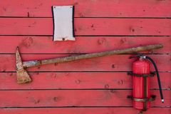 Red fire stand with axe and fire extinguisher stock images