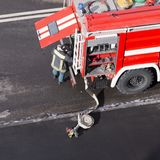 Red fire truck arrived on an emergency call. High angle view. Square image royalty free stock image
