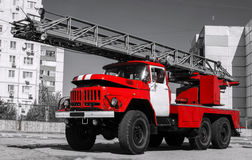 Red fire truck with a ladder. Stock Photos