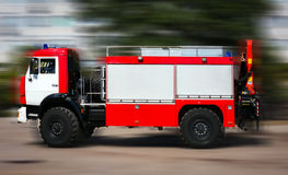 Red fire truck in motion. Royalty Free Stock Photos