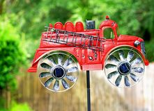 Red Fire Truck Wind Mill Royalty Free Stock Image
