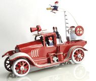 Red Firefighter truck toy. Vintage tin toy, red Firefighter truck stock photo