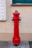 Red fireplug. By the street in Germany Royalty Free Stock Image