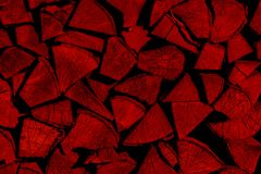 Red firewood background stacked in a woodpile stock images