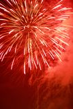 Red firework. A red firework exploding on a smoky background Royalty Free Stock Images