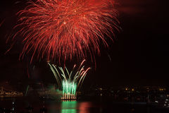 Red firework over the water Royalty Free Stock Images