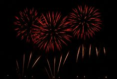 Red fireworks. Beautiful fireworks on the night sky Royalty Free Stock Images