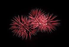Red fireworks in the black sky Stock Photo
