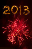 Red fireworks burst and 2013 in sparklers royalty free stock images