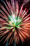 Red fireworks at the city festival. royalty free stock image