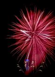 Red fireworks like star with city hall clock Stock Image