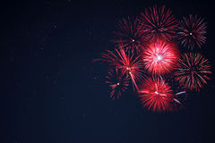 Red  fireworks located right side over night sky Stock Photos