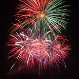 Red fireworks in the night sky Royalty Free Stock Image