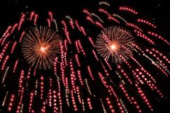 Red fireworks show. Red fireworks in different shapes with copy space, native space, black background Royalty Free Stock Photos