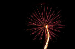 Red fireworks. A single burst of red fireworks in the night sky Stock Photo